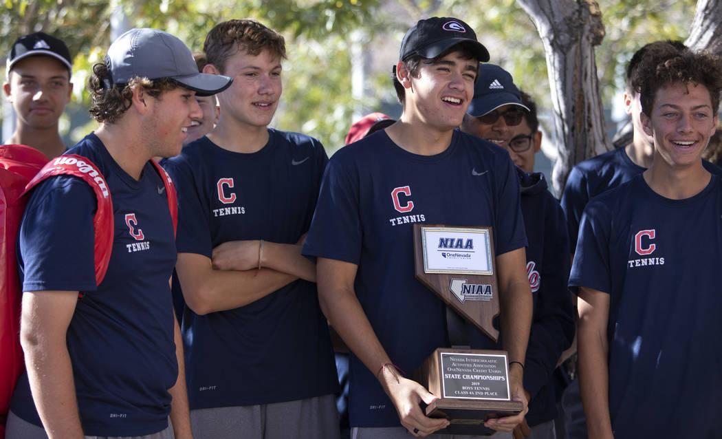 The Coronado High School varsity boys tennis team accepts their class 4A second place state cha ...