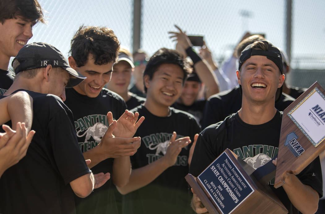 Palo Verde captain Jack Kostrinsky accepts the 4A varsity boys state championship trophy as his ...
