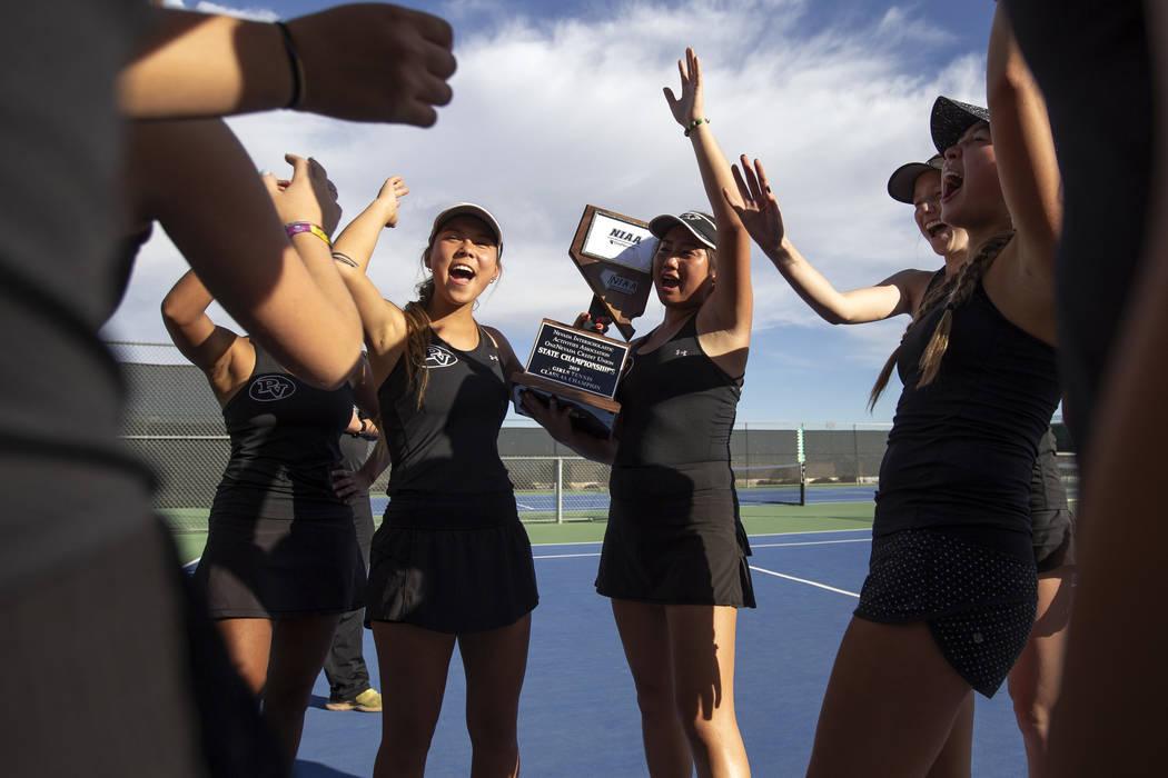 Palo Verde girls varsity tennis captains Devon Yamane, left, and Caroline Hsu, right, thank the ...