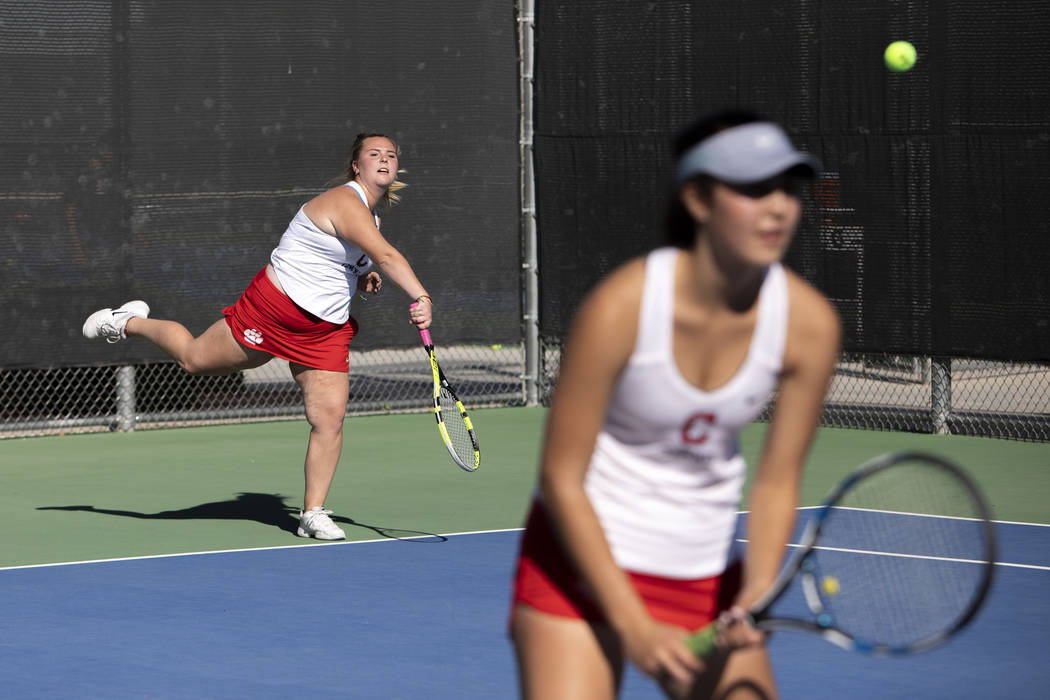 Coronado's Kaylen Heiss serves to Palo Verde on the court with her partner Sidra Wohlwend on We ...