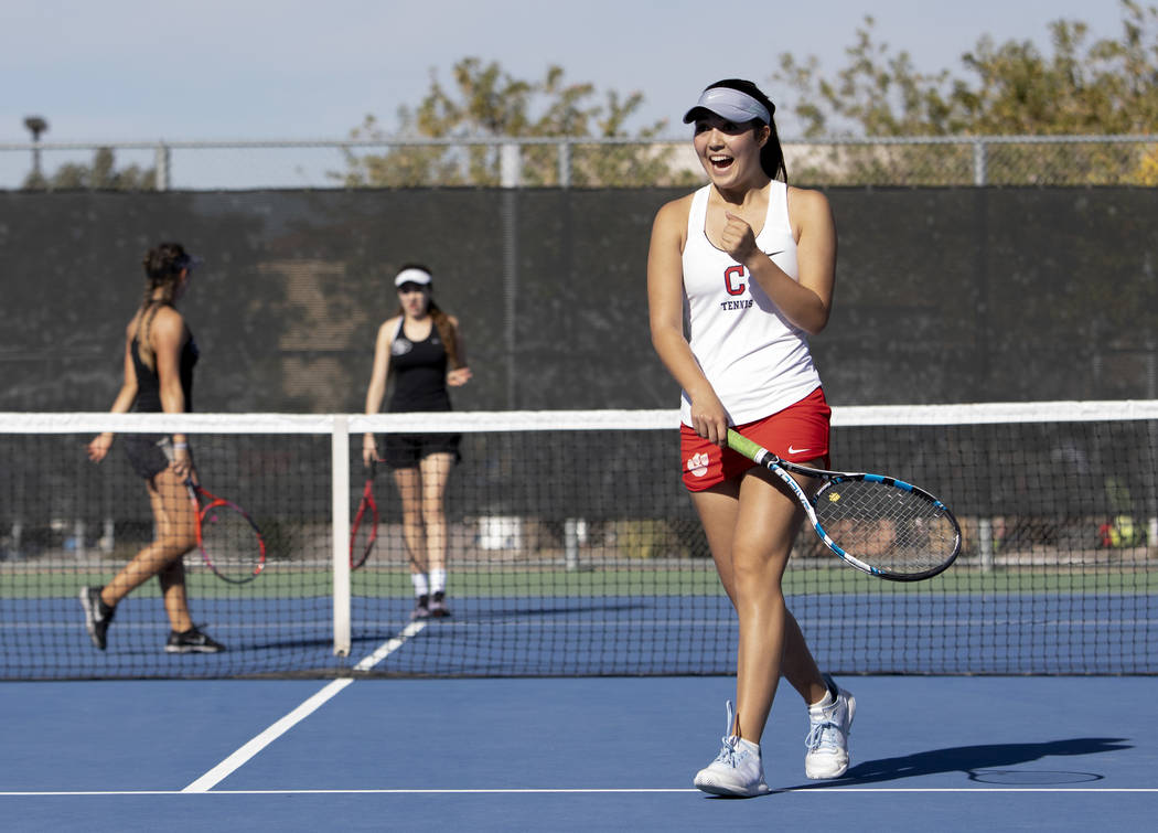 Coronado's Sidra Wohlwend cheers as she and her partner Kaylen Heiss beat Palo Verde 7-5 during ...