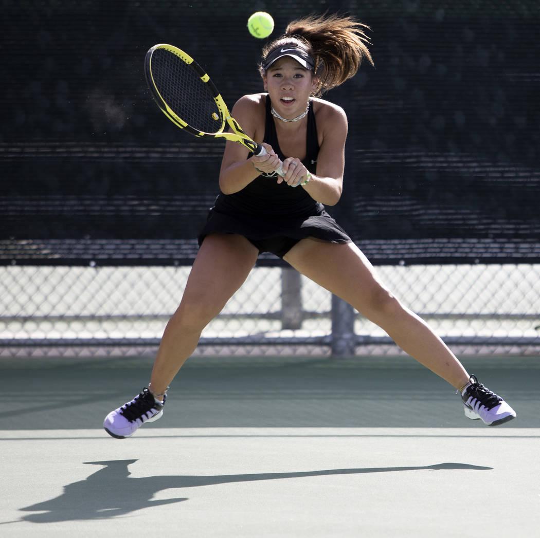 Palo Verde's Roxy Okano eyes to hit the ball during a doubles match against Coronado's Sofia Po ...