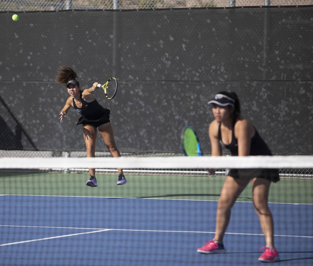 Palo Verde's Roxy Okano serves during a doubles match against Coronado's Sofia Potamitis and Av ...