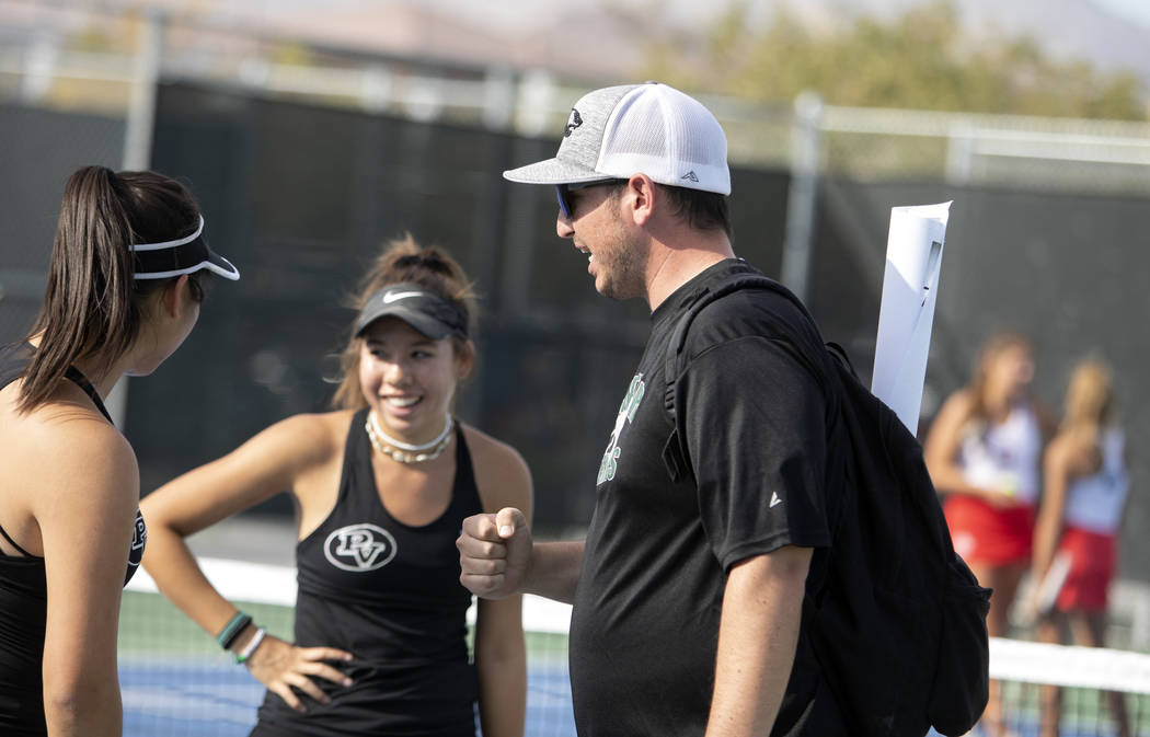 Palo Verde women's varsity tennis coach Tyler Marchant, right, encourages players Caroline Hsu, ...