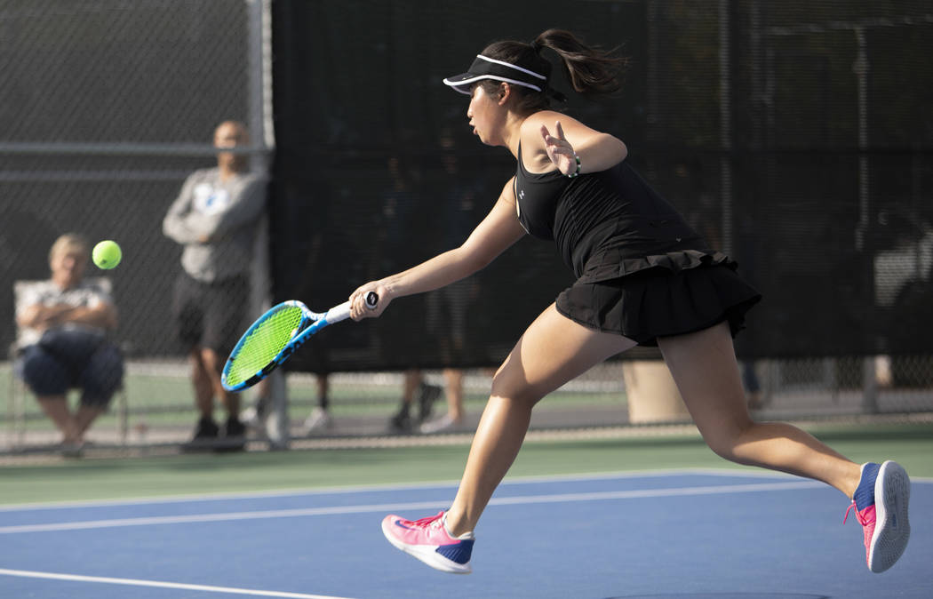 Palo Verde's Caroline Hsu reaches to hit the ball during a doubles match against Coronado on We ...