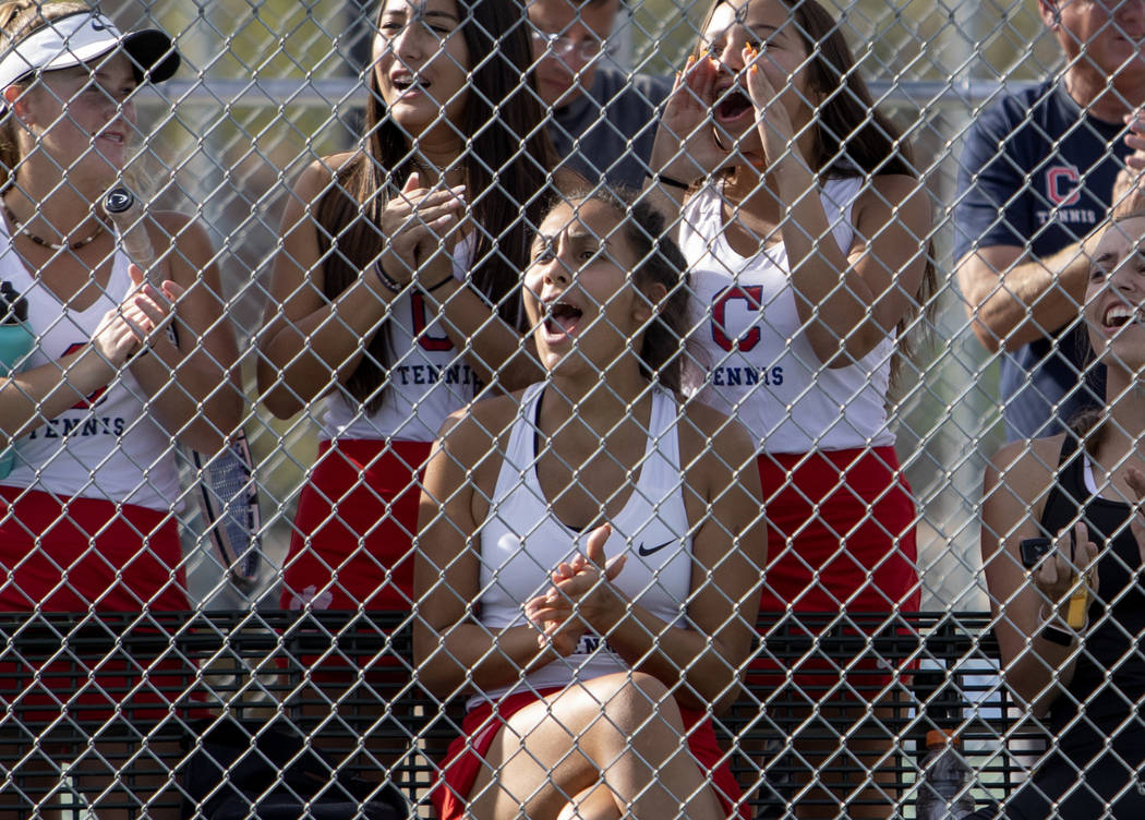 Coronado cheers on their teammates during a doubles match in the class 4A state championship on ...