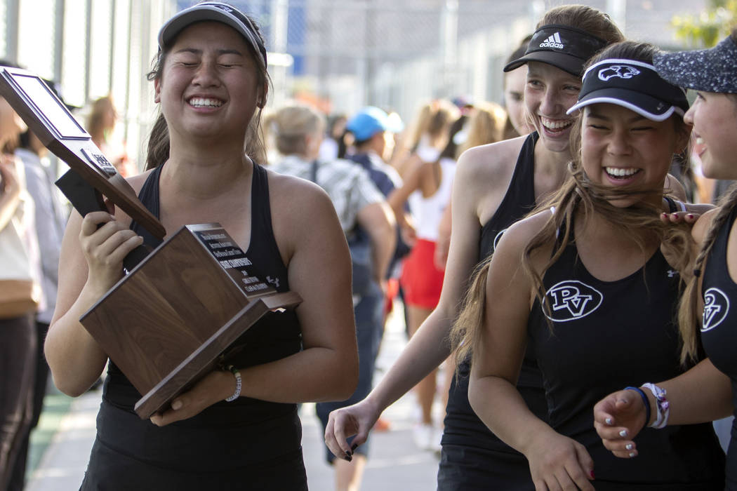 Palo Verde girls varsity tennis captain Caroline Hsu, left, cries after accepting the class 4A ...