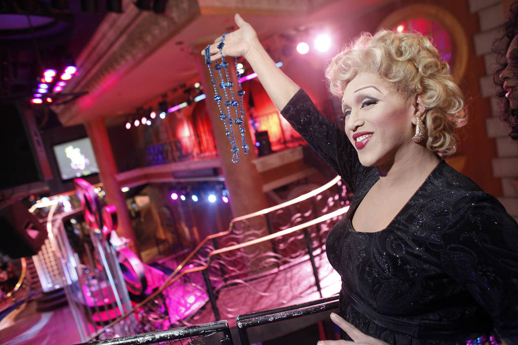 """Joseph Santellana of """"Divas Las Vegas"""" throws beads from a float during a special """"Show in the ..."""