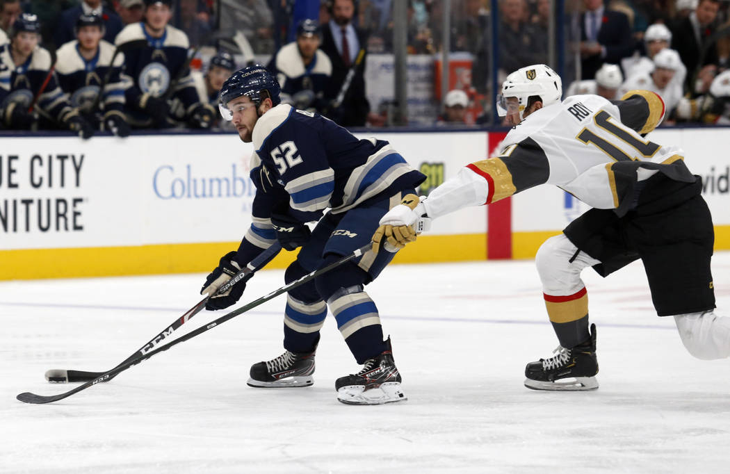 Columbus Blue Jackets forward Emil Bemstrom, left, of Sweden, controls the puck in front of Veg ...