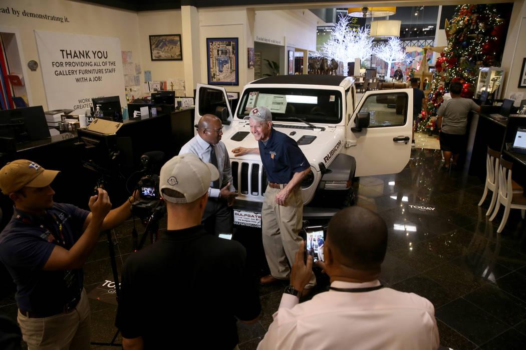 "Houston furniture store owner Jim ""Mattress Mack"" McIngvale, 68, left, films a commer ..."