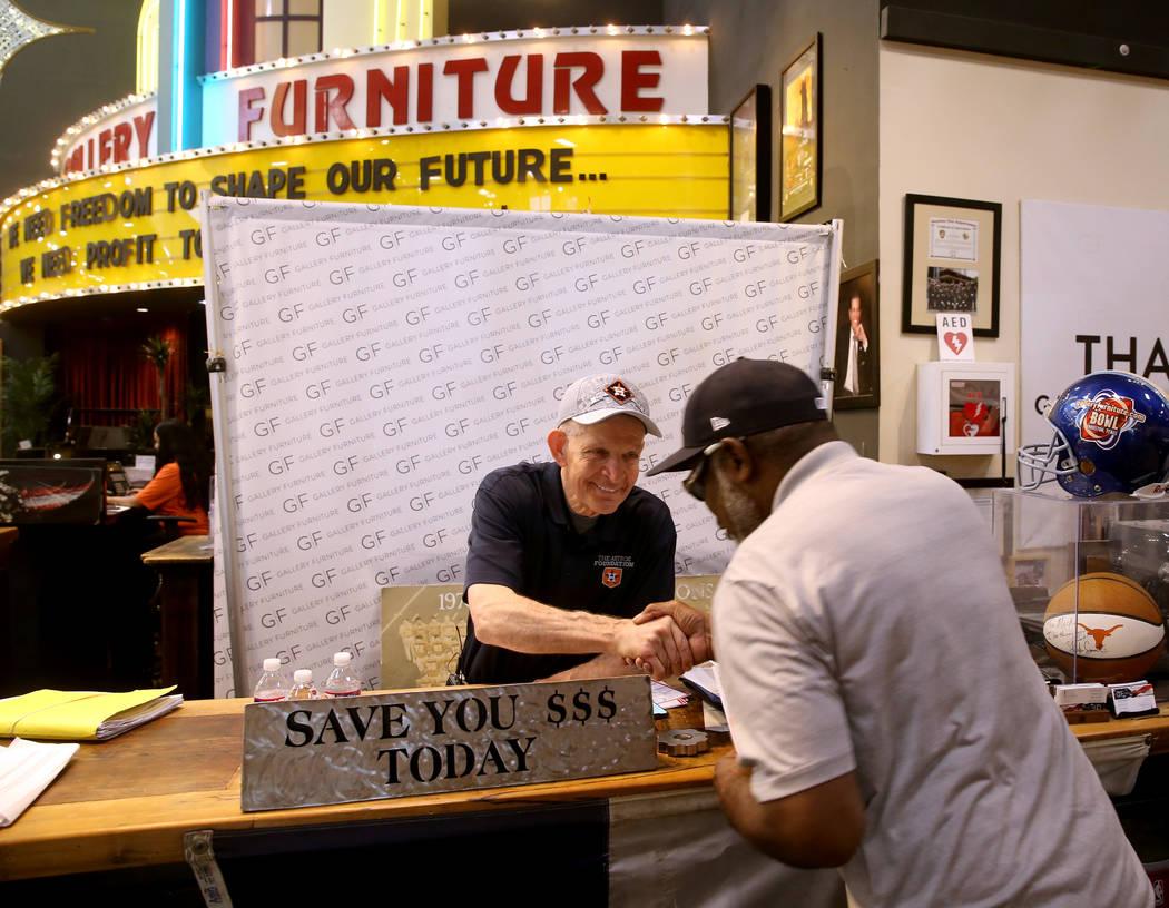 "Houston furniture store owner Jim ""Mattress Mack"" McIngvale, 68, greets Griffin Jacks ..."
