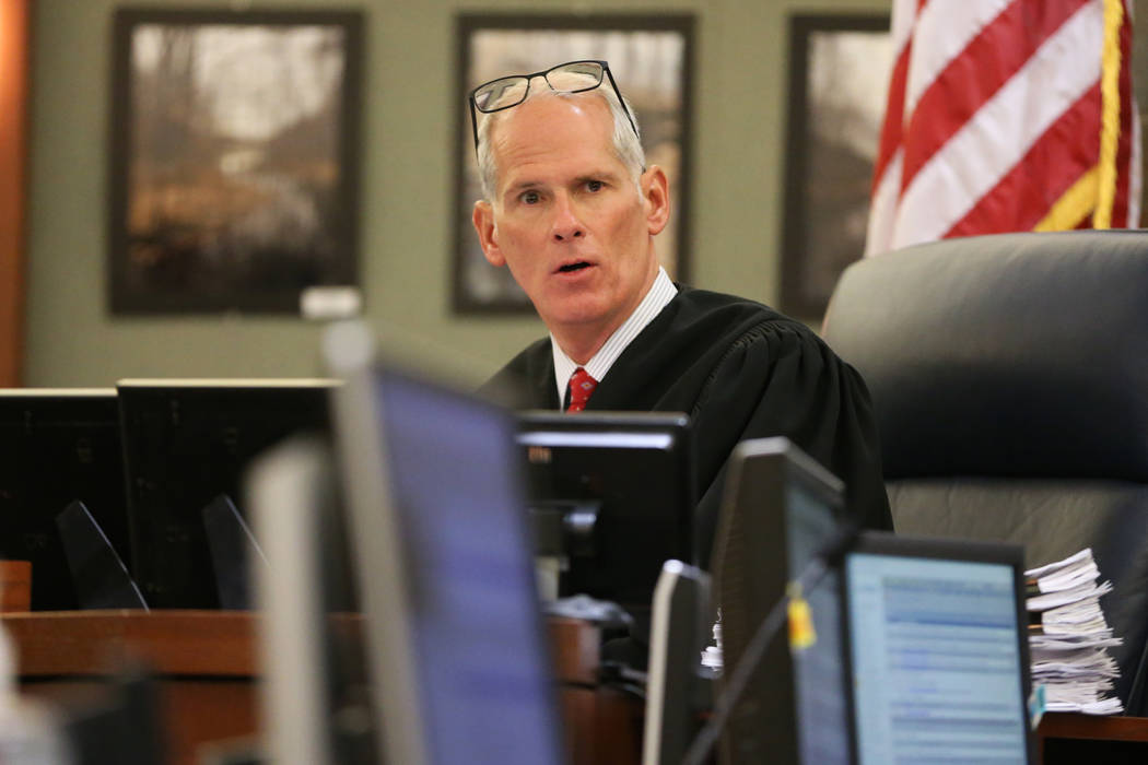 District Judge Douglas Herndon listens during a hearing for Giovanni Ruiz, accused of raping an ...