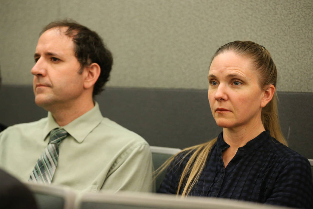 Sean Davis, left, and his wife, Kara, listen during a court hearing for Giovanni Ruiz, accused ...