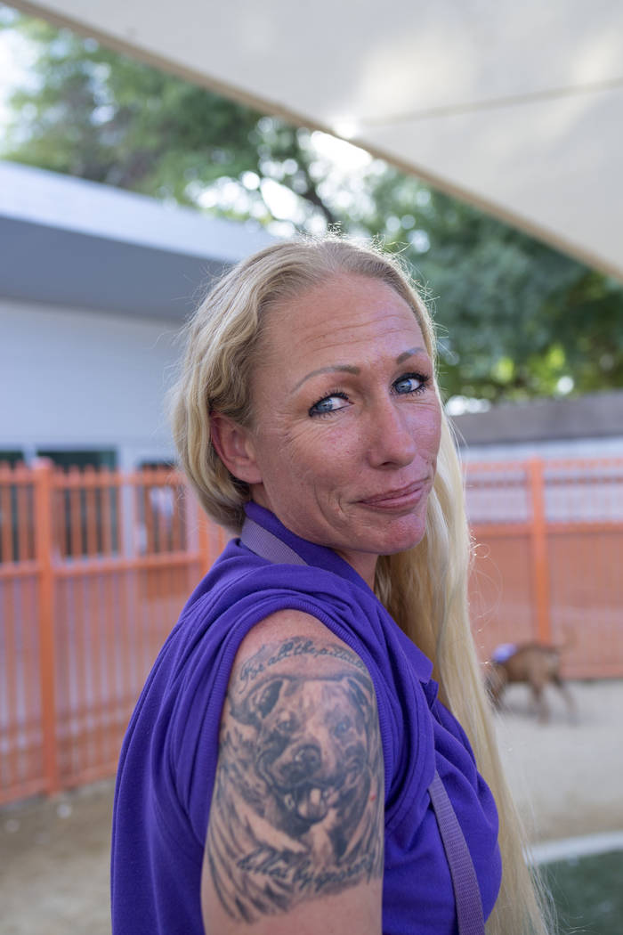 Nicole Fox, an enrichment specialist for the Animal Foundation, shows off her pitbull tattoo at ...