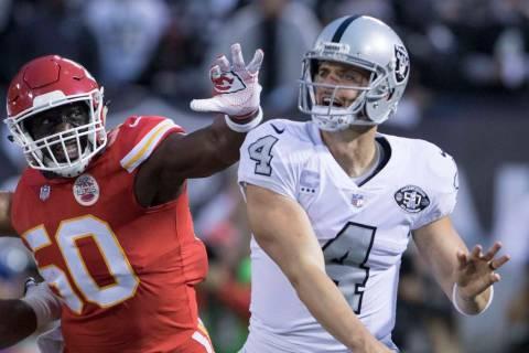 Oakland Raiders quarterback Derek Carr (4) throws the football as Kansas City Chiefs outside li ...