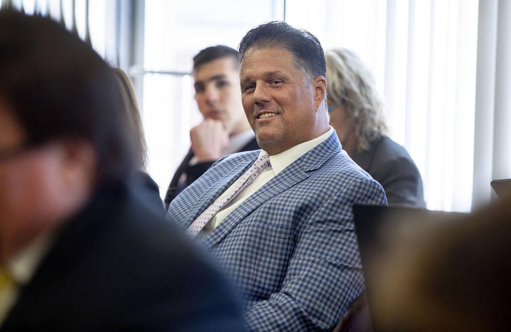 Las Vegas resident David Harold Moore listens as a letter of resignation from Nevada dental boa ...