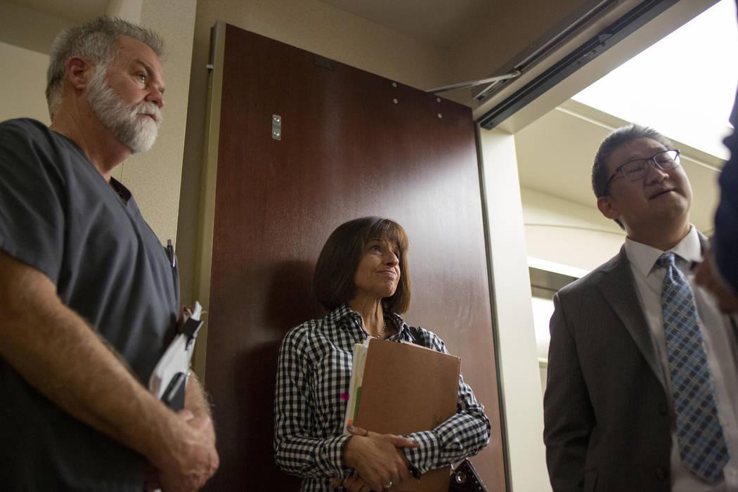 Nevada dental board members Dr. Daniel Kevin Moore, left, consumer member Gabrielle Cioffi, cen ...