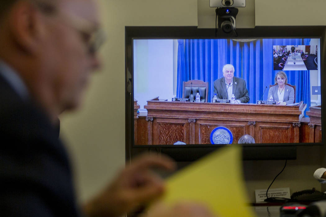 Nevada Gov. Steve Sisolak, left, and Lt. Gov. Kate Marshall joins the video conference for an a ...