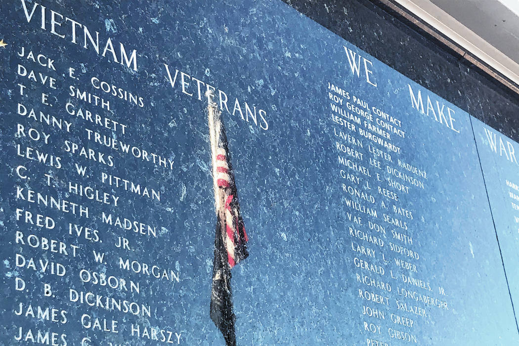 A reflection of the American flag is seen Nov. 7 on a Vietnam veterans panel on Henderson's V ...