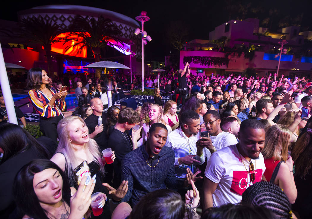 Attendees dance and listen to music as performers entertain by the outdoor stage during the gra ...