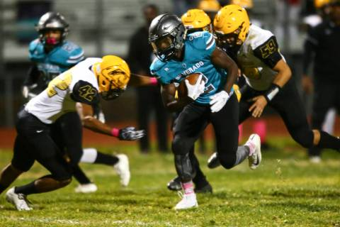 Silverado's Aginae Cunningham (2) runs the ball against Clark during the first half of a footba ...