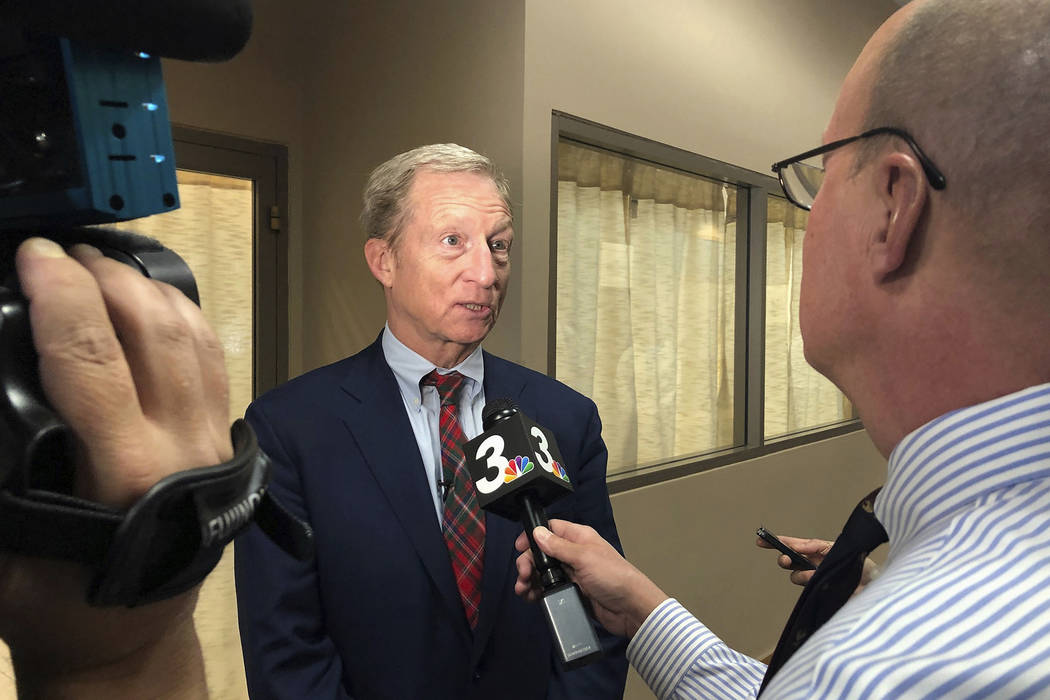 Democratic presidential candidate Tom Steyer speaks to reporters before hosting a town hall in ...