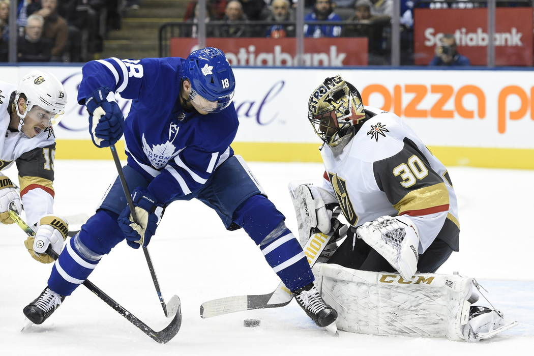 Vegas Golden Knights goaltender Malcolm Subban (30) stops Toronto Maple Leafs left wing Andreas ...