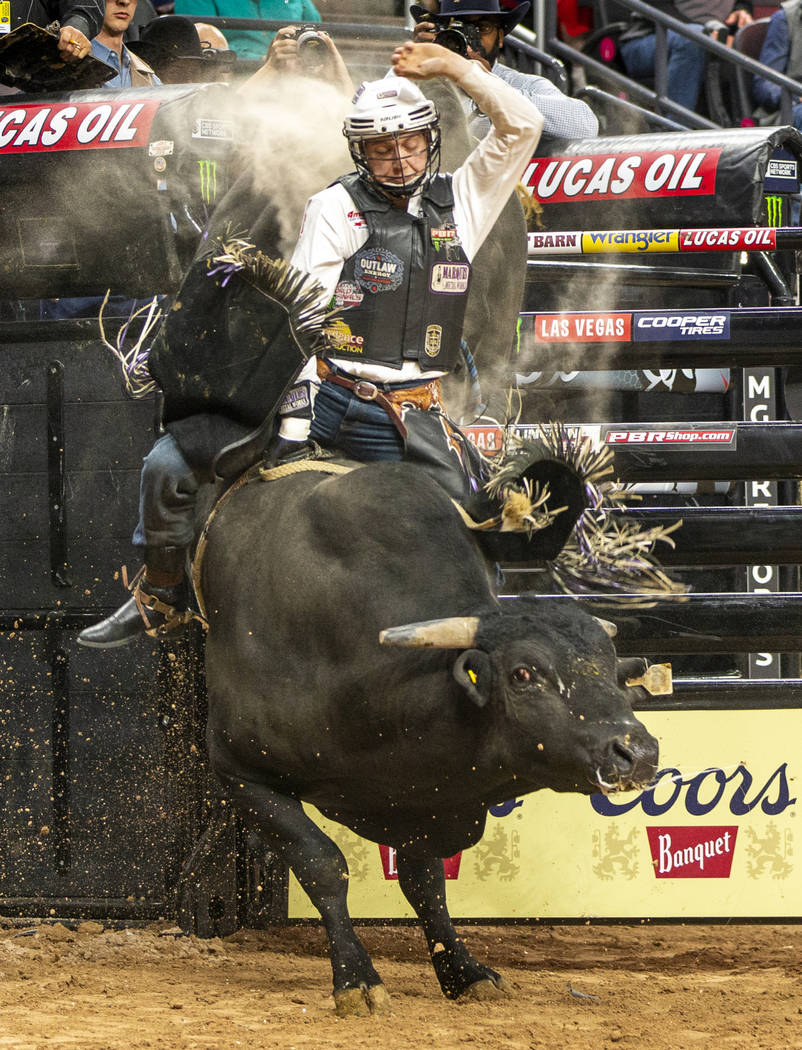 Mason Taylor rides El Big Bad for just under eight seconds during the PBR World Finals at T-Mob ...