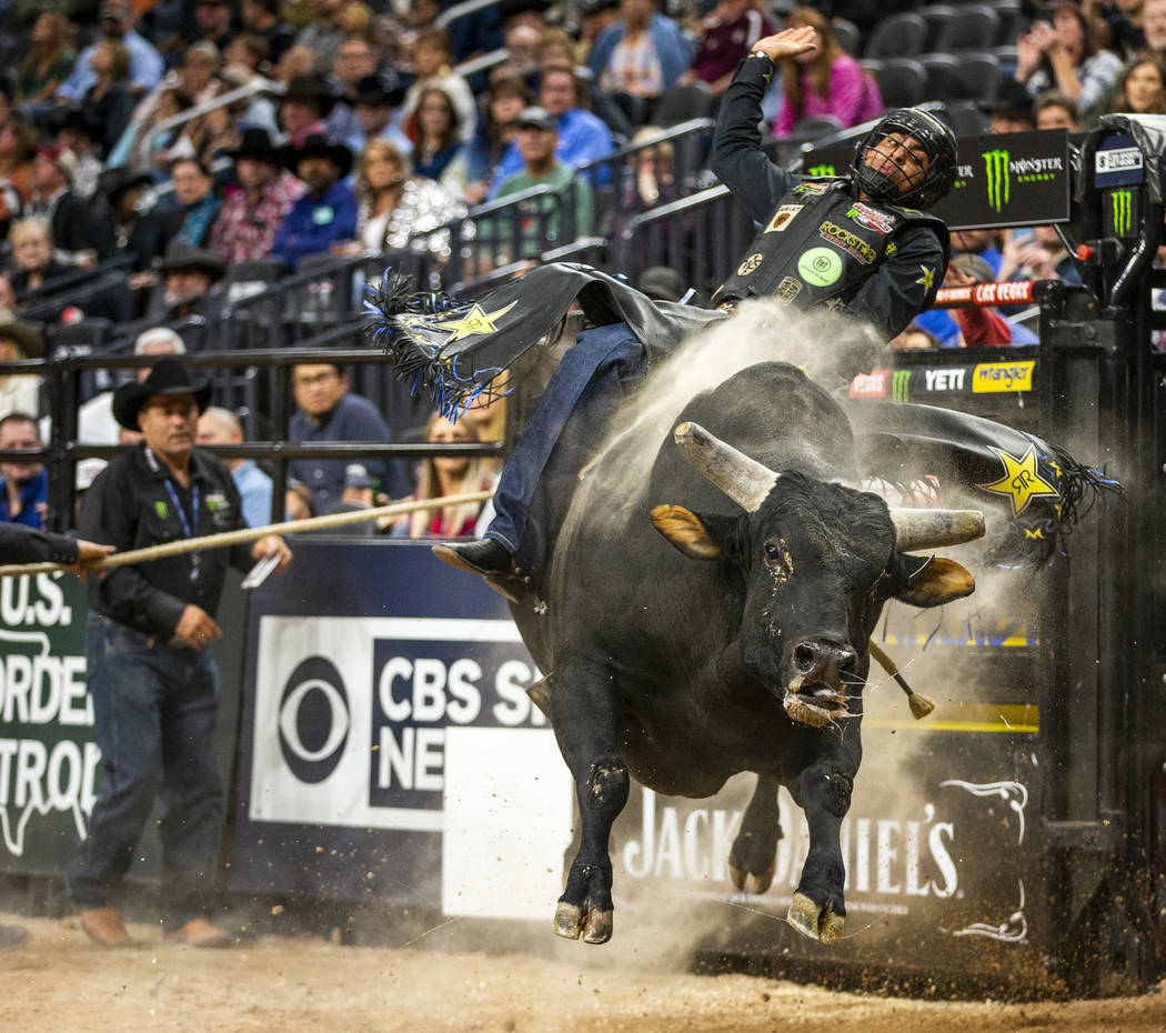 Luciano De Castro hangs tight atop Gangster Party during the PBR World Finals at T-Mobile Arena ...
