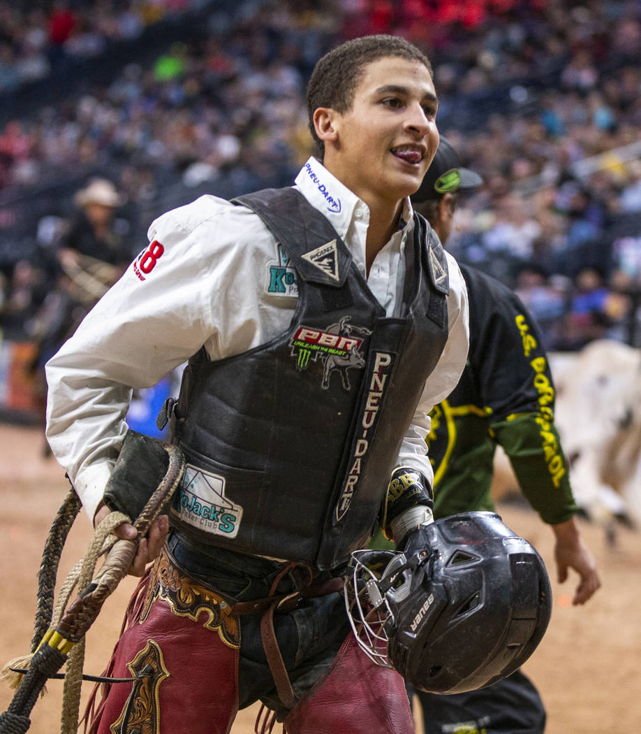 Dalton Kasel is pleased with his ride on Too Dirty during the PBR World Finals at T-Mobile Aren ...