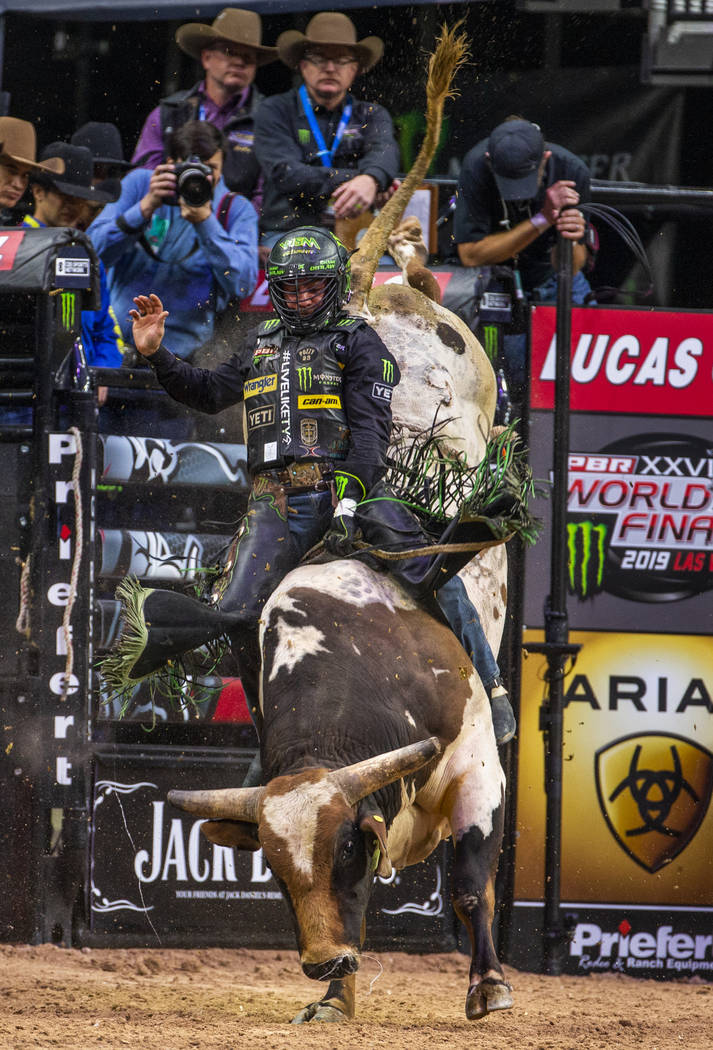 Chase Outlaw sits back atop of Foghorn Leghorn during the PBR World Finals at T-Mobile Arena on ...