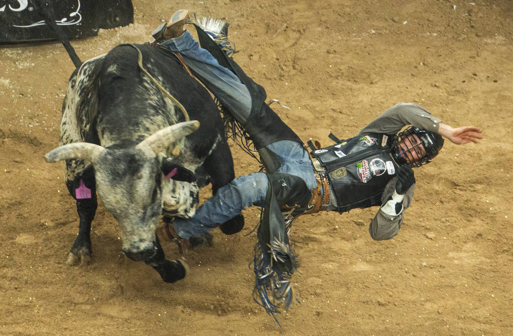 Jared Parsonage comes off sideways from Good Night Robicheaux during the PBR World Finals at T- ...