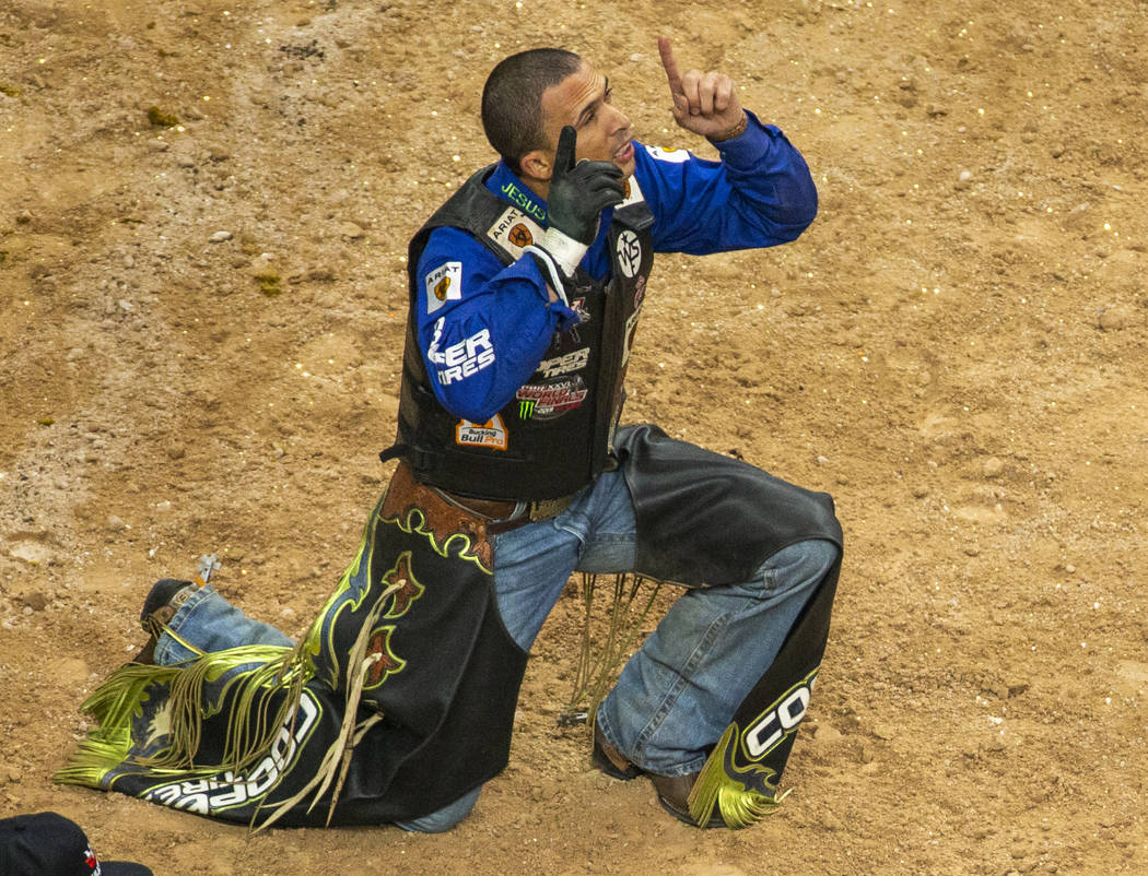 Eduardo Aparecido celebrates a successful ride on Chiseled during the PBR World Finals at T-Mob ...