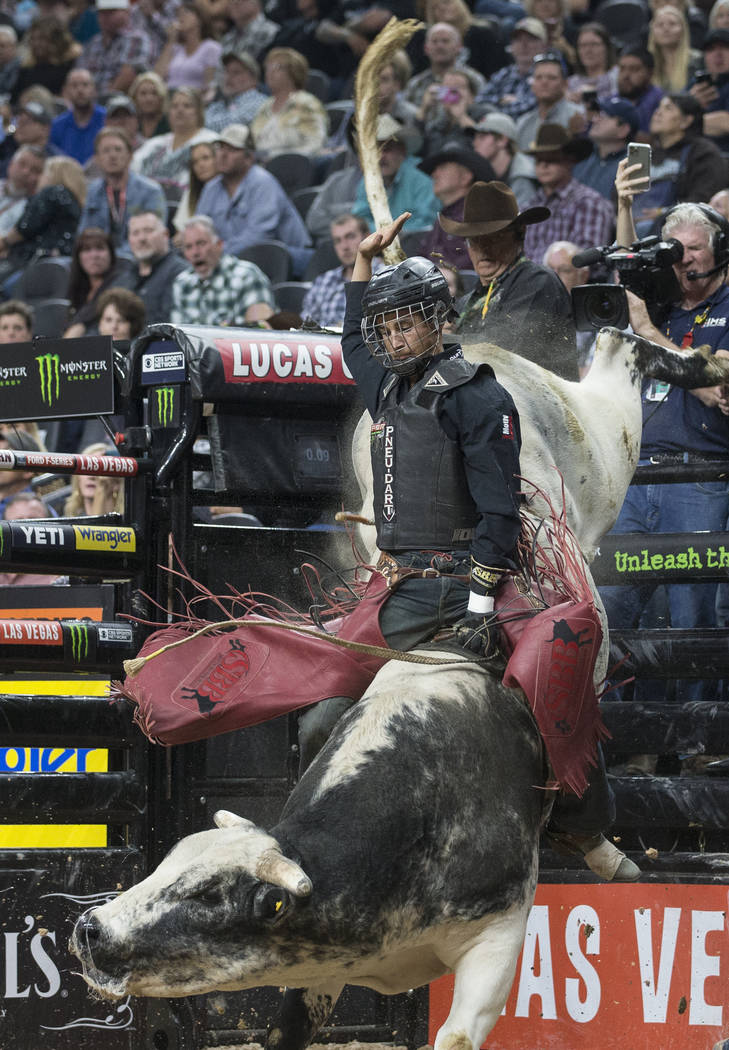 Dalton Kasel rides Sosa's Alley Cat during day two of the PBR World Finals on Thursday, Nov. 7, ...