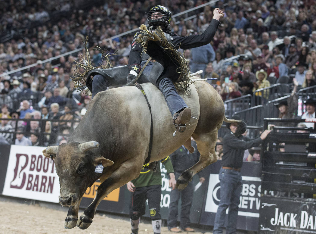 Cody Teel rides SweetPro's Bruiser during day two of the PBR World Finals on Thursday, Nov. 7, ...