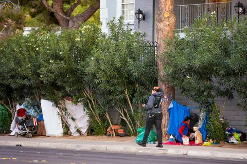 People make temporary homes amongst the trees off E. Twain Ave. near Molasky Family Park on Mon ...