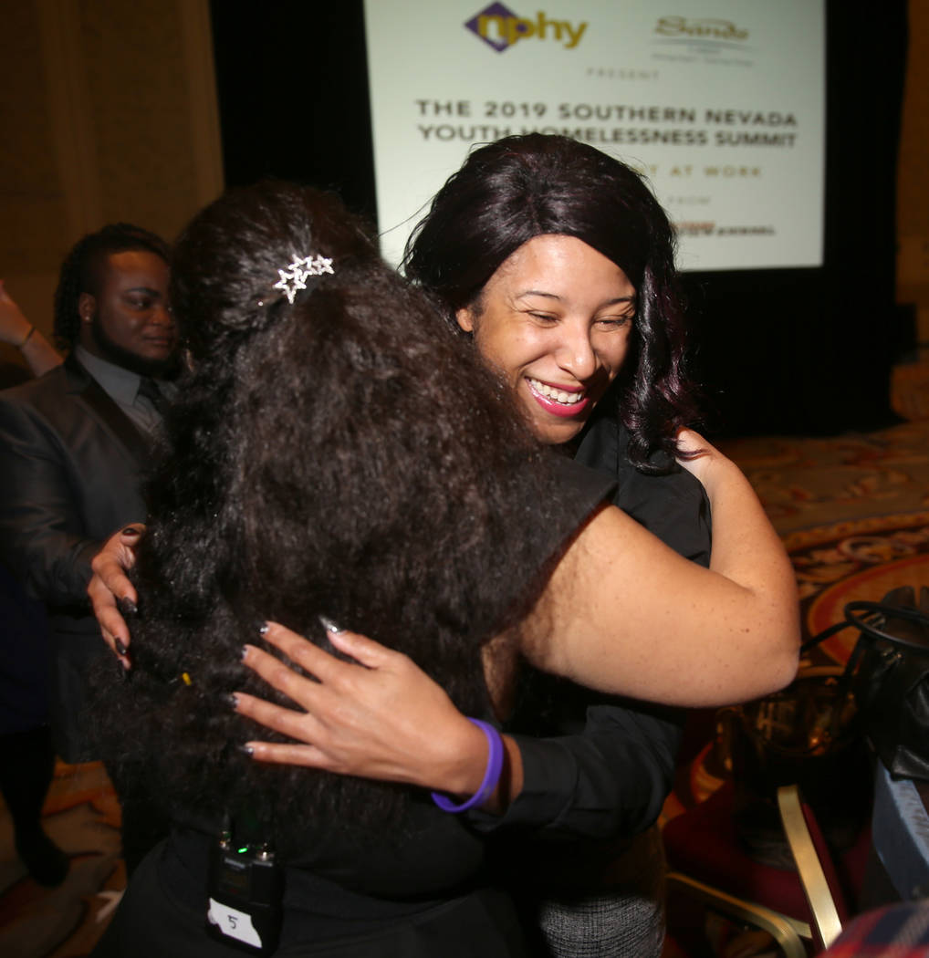 Tanya Smith, a course assistant at Nevada State College, right, hugs Nevada Partnership for Hom ...