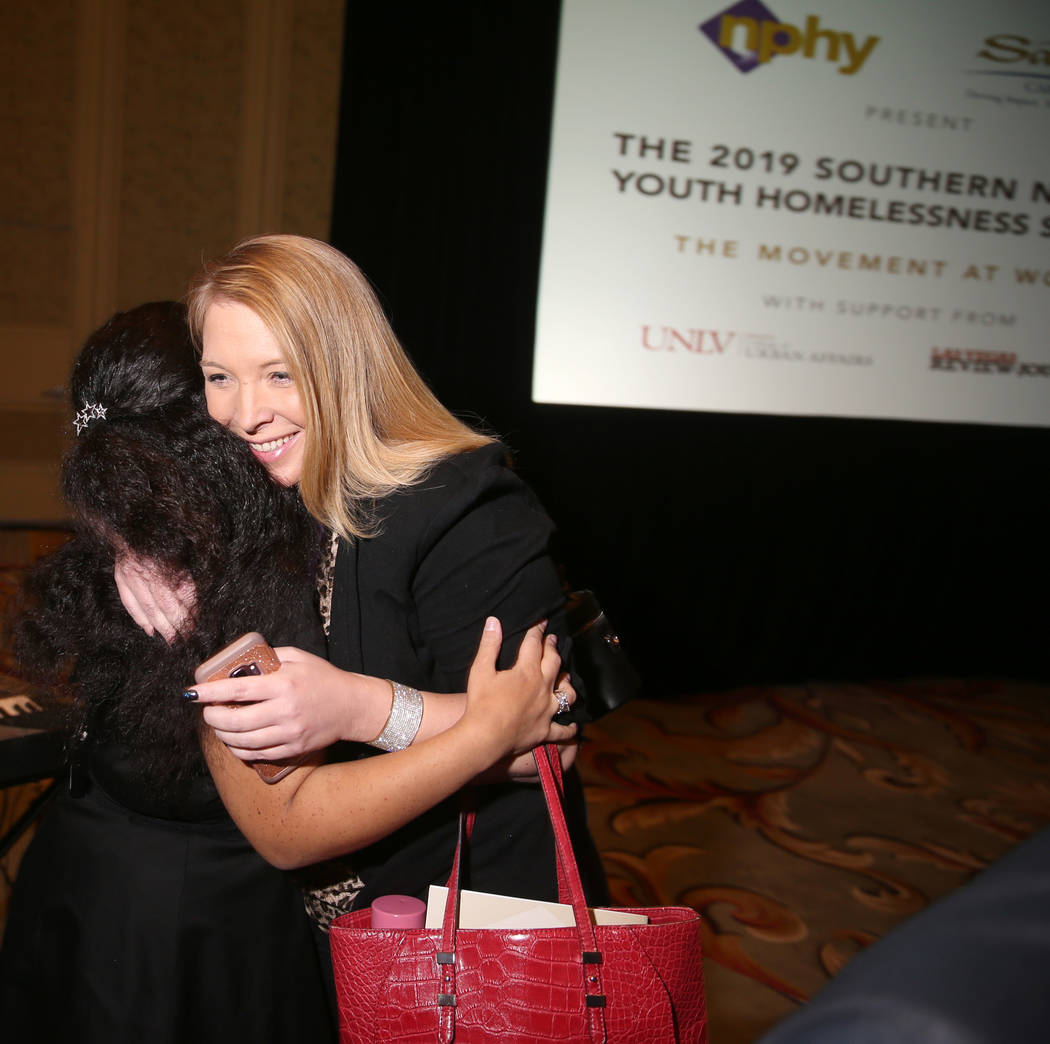 Jessica Halling, program director at St. Jude's Ranch for Children, right, hugs Nevada Partners ...