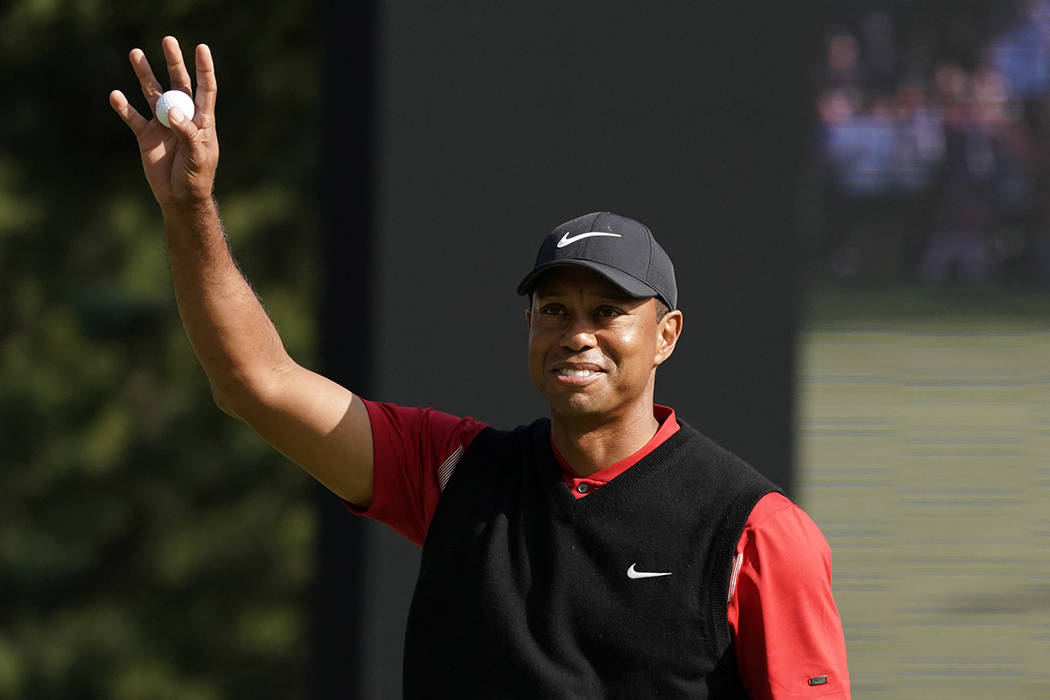 Tiger Woods of the United States reacts after his putt on the 18th hole during the final round ...