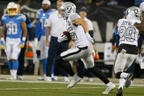 Oakland Raiders free safety Erik Harris (25) runs after intercepting a pass against the Los Ang ...