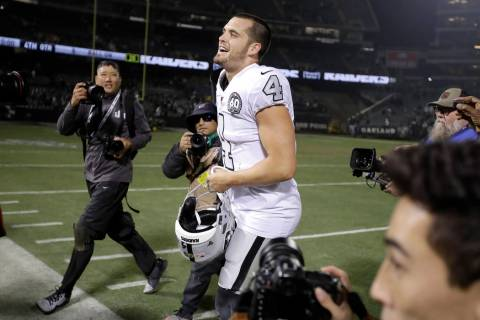 Oakland Raiders quarterback Derek Carr (4) celebrates after the Raiders defeated the Los Angele ...