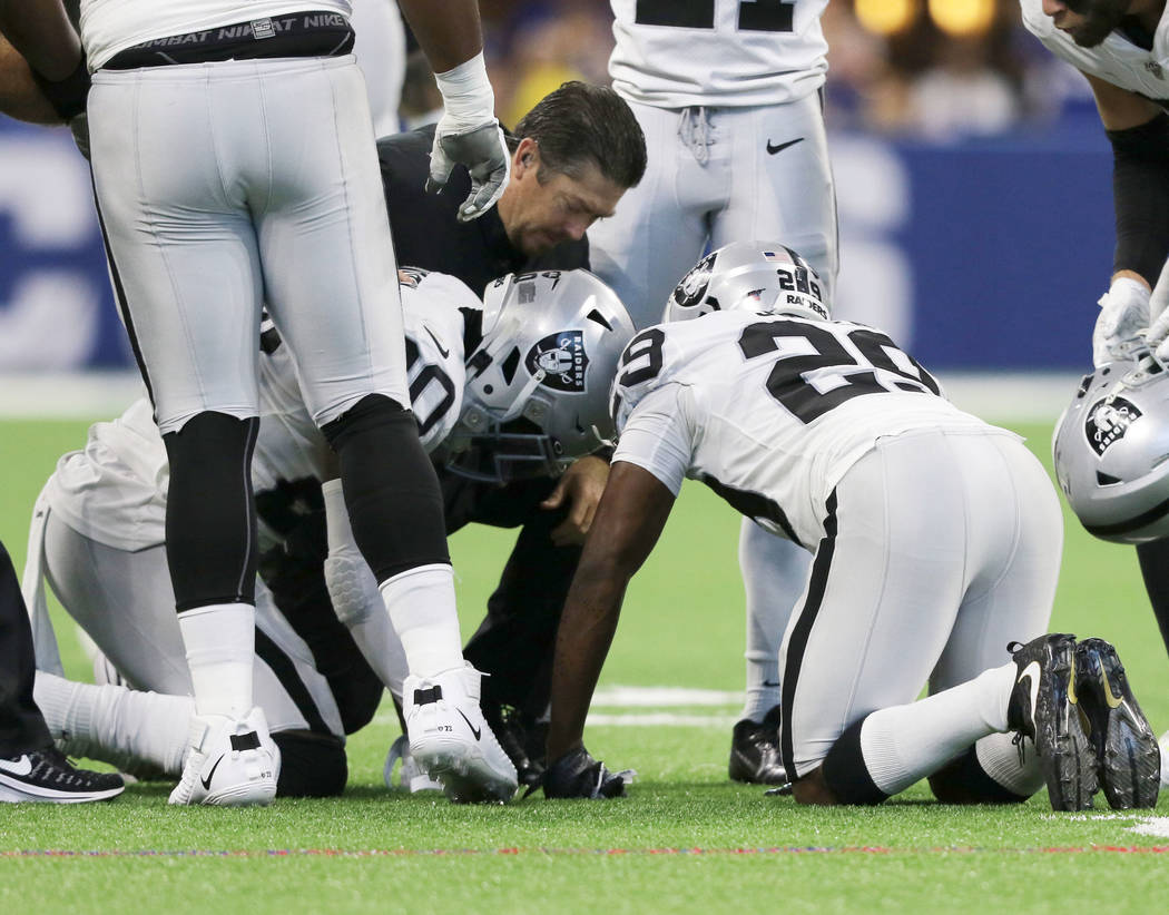 Oakland Raiders cornerback Daryl Worley (20) remains on the field after a play and is checked o ...