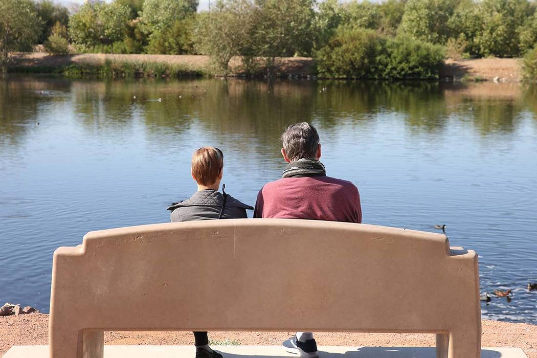 Two people, who declined to give their names, relax at Henderson Bird Viewing Preserve on Thurs ...