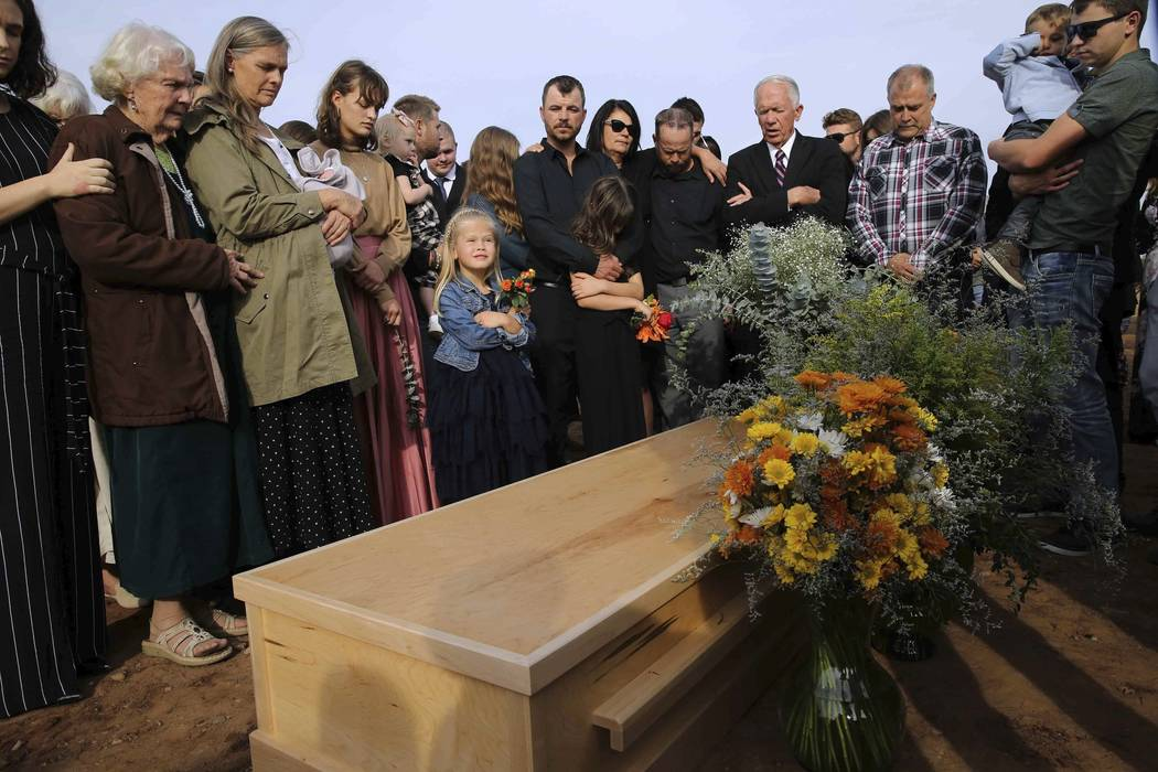 Family and friends attend the burial service of Christina Langford Johnson the last victim of a ...