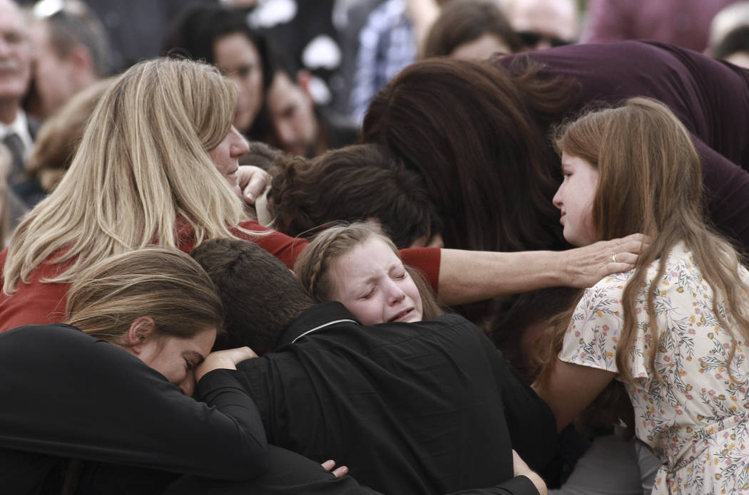Family and friends weep during the funeral service for Dawna Ray Langford, 43, and her sons Tre ...
