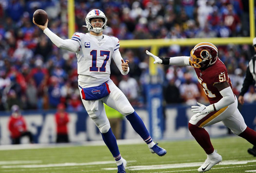 Buffalo Bills quarterback Josh Allen (17) passes against the Washington Redskins during the sec ...