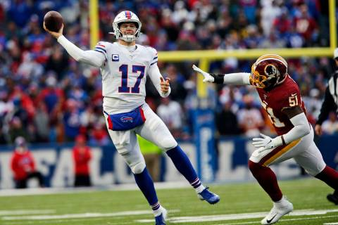 Buffalo Bills quarterback Josh Allen (17) passes against the Washington Redskins during the sec ...