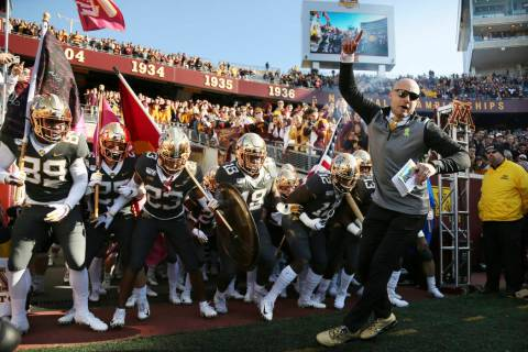 FILE - In this Oct. 26, 2019, file photo, Minnesota head coach P.J. Fleck leads him team on the ...