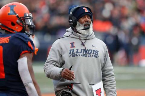 Illinois head coach Lovie Smith looks up at the scoreboard during the second half of an NCAA co ...