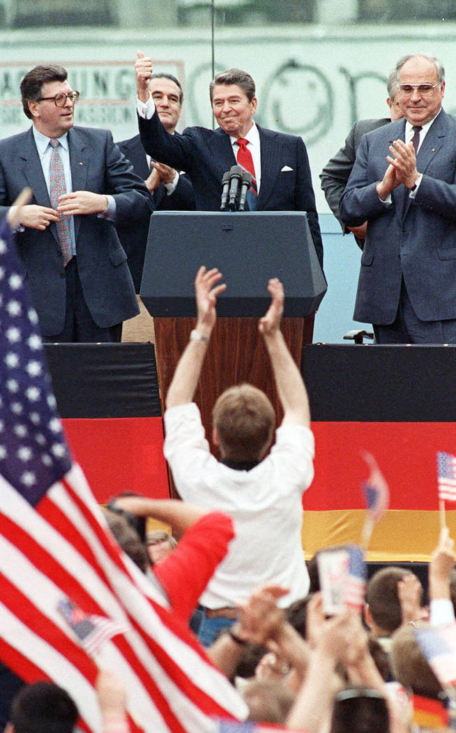 FILE - This Friday, June 12, 1987 file photo shows President Reagan giving a thumbs up sign aft ...
